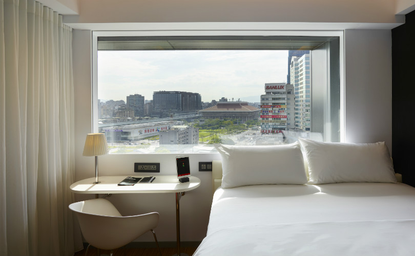 Plushy beds and digital amenities await in your room at citizenM Taipei North Gate