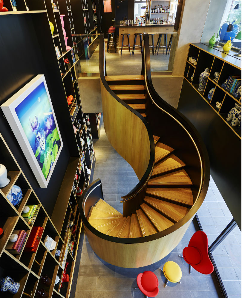 An oak-cladded spiral staircase welcomes you into the vibrant citizenM Taipei North Gate