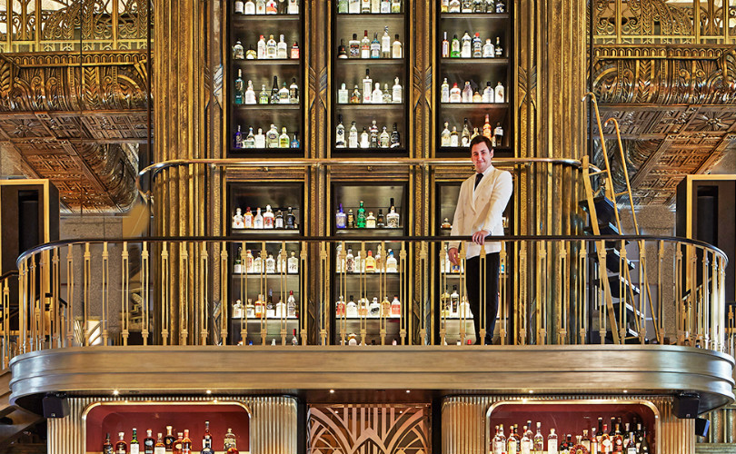 Master of Gin, Jason Williams at the foot of the gin tower