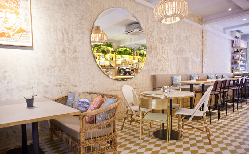 Mosaic-tiled flooring and rattan furniture offers Merci Marcel a chic, laidback vibe that makes it the perfect locale for dining with friends or family