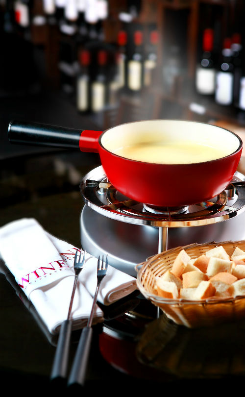 An oozy Vacherin and Gruyère cheese fondue from Wine Universe