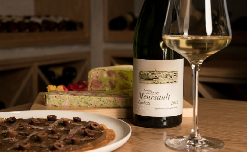 Dishes like the La Pissaladière (left) are paired with wines like the 2012 Domaine Roulot Meursault Louchets