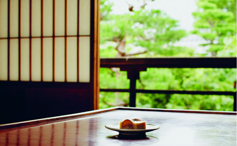 Enjoying Obusedo's chestnut yokan in the serenity of Obuse town, Nagano Prefecture.