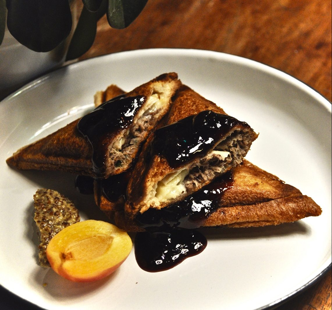 Toasties with duck rilette and brie. Served with wholegrain mustard and port-cherry compote